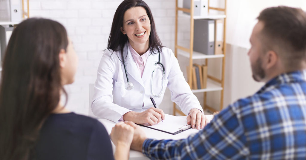 Good analysis results. Professional doctor consulting young married couple at office; blog: Fertility Consultation: 7 Questions to Ask at Your First Appointment
