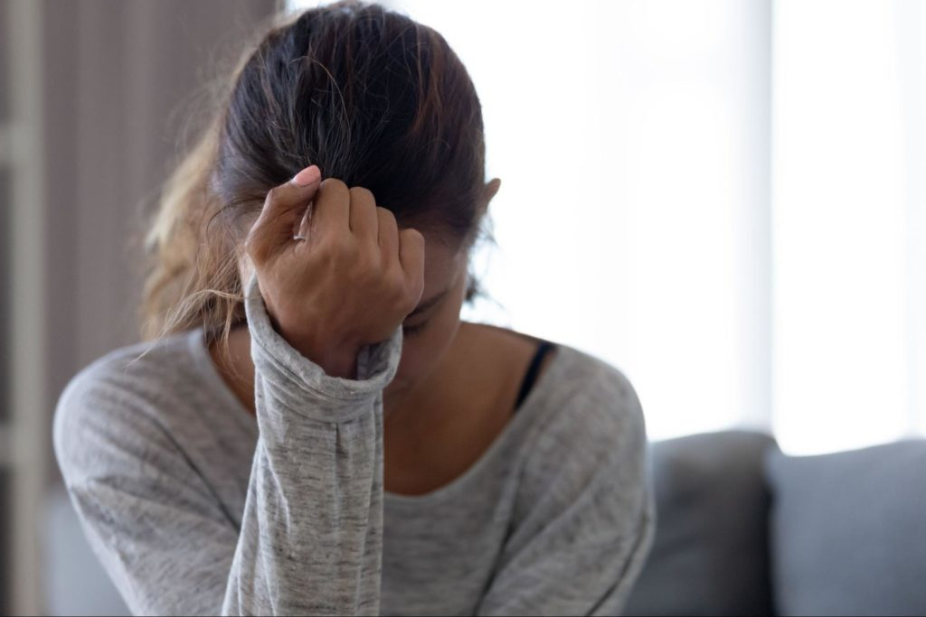 a woman struggling with anxiety and depression