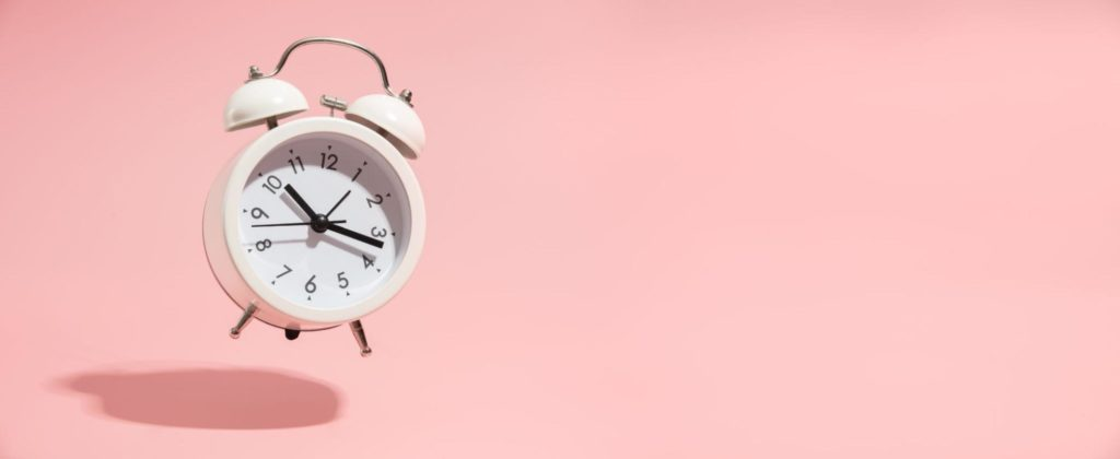 a ringing clock to symbolize the importance of timing in getting pregnant